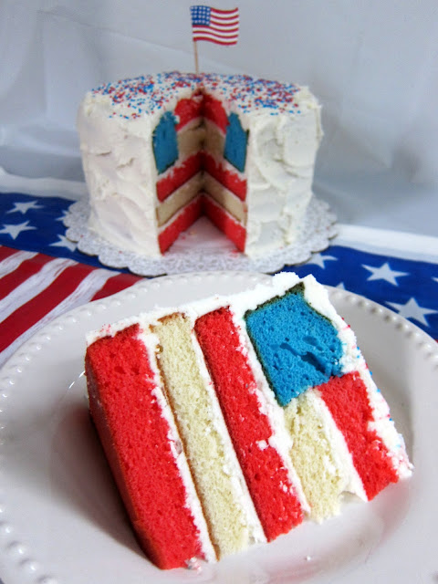 Flag Cake Recipe - transform cake mix into a festive Flag Cake that is perfect for Memorial Day, 4th of July, and Labor Day! It is actually really easy! Bake the cake layers, make a few cuts and assemble. SO impressive and festive!