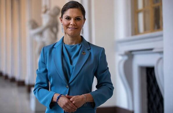 Princess Victoria wore a blue narina blazer from Tiger of Sweden, and a mist blue silk satin blouse from same brand