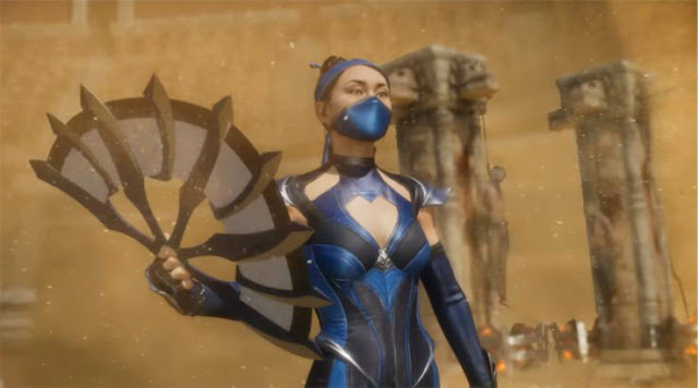 Kitana a girl wearing blue ninja suit wielding a bladed fan standing in a desert storm
