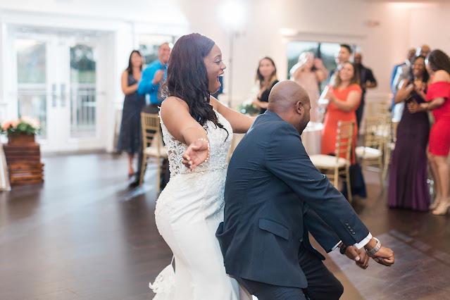bride and groom dancing into reception