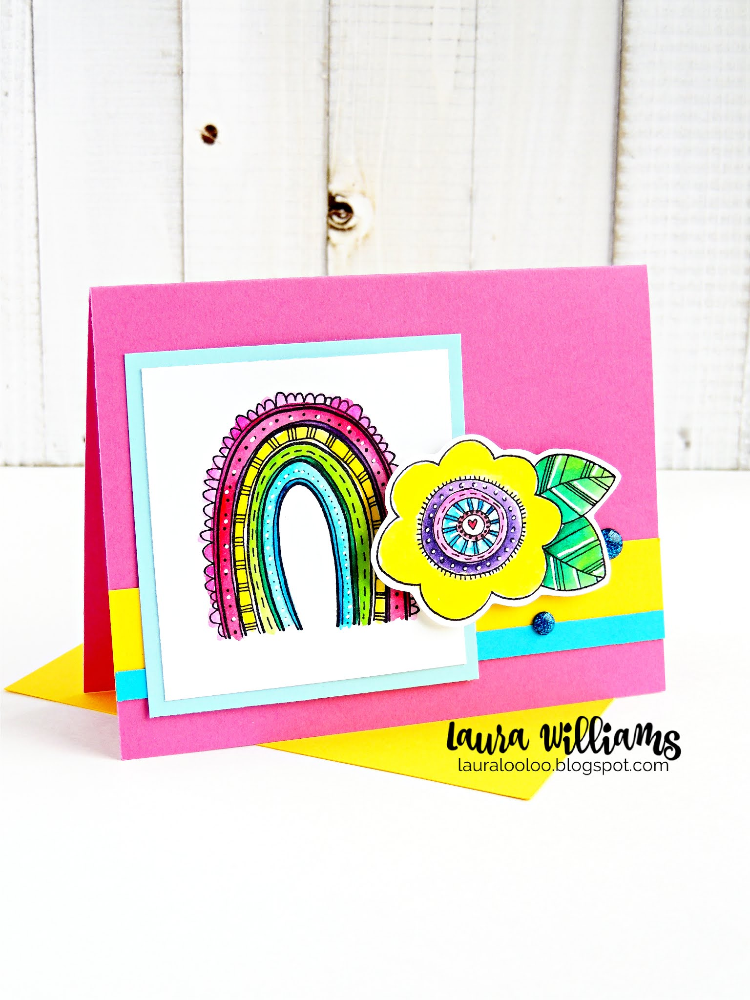 Make a bright and cheery handmade card using a rainbow stamp and flower stamp from Impression Obsession. The Rainbow Scallops and Rainbow Flower stamps from IO are perfect for cheerful cardmaking projects, scrapbook, and paper crafts. Visit my blog to see more ideas with these sweet stamps.