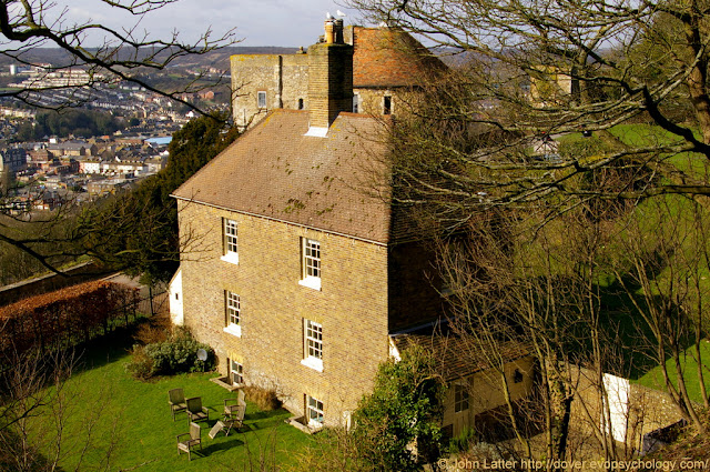 Garrison Battery Sergeant Major's House, then Custodian of the Castle, now English Heritage Holiday Cottage. Also  in view: Outer Curtain Wall, Knight's Road, Peverell's Gateway, Queen Mary's Tower, Town Hall, Police Station, Robsons Yard, Park Inn. Grade II Listed Building.