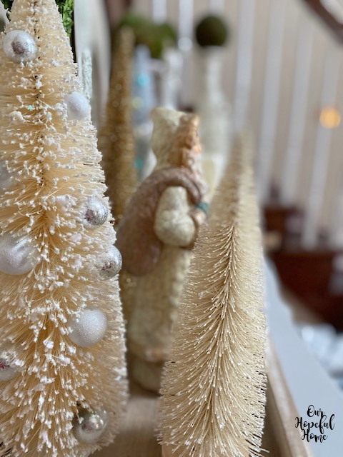 white bottle brush tree with silver ornaments winter decor