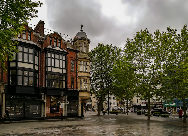 Photo of impressive architecture on the corner of Market Square on a wet day in Salisbury
