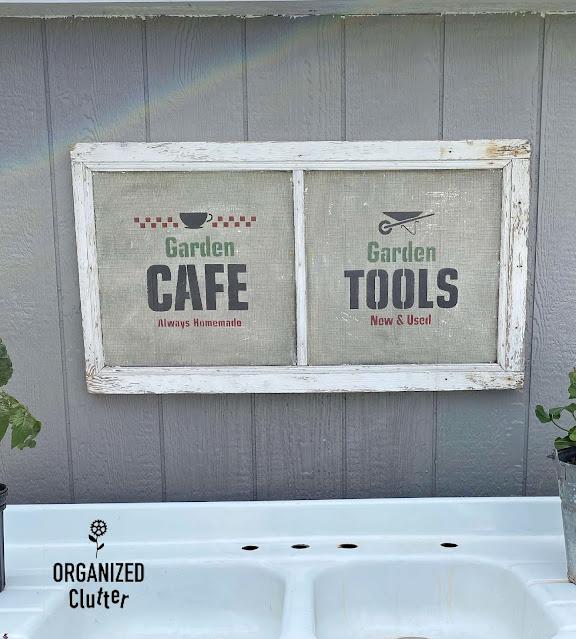 Photo of window screen garden sign