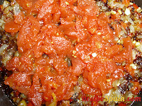 Chopped tomato in a pan