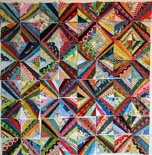 The string blocks have darker strings on the center diagonals that create colorful Xs in this layout.