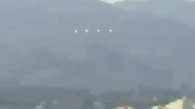 The UFO Orbs are seen changing formation over Japan.