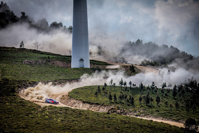 Dani Sordo WRC In Front of windmill with dust everywhere