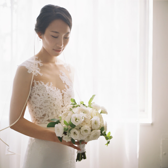 The bride poses in her Pronovias wedding gown and bouquet by Designs by Ahn | Karen Hill Photography