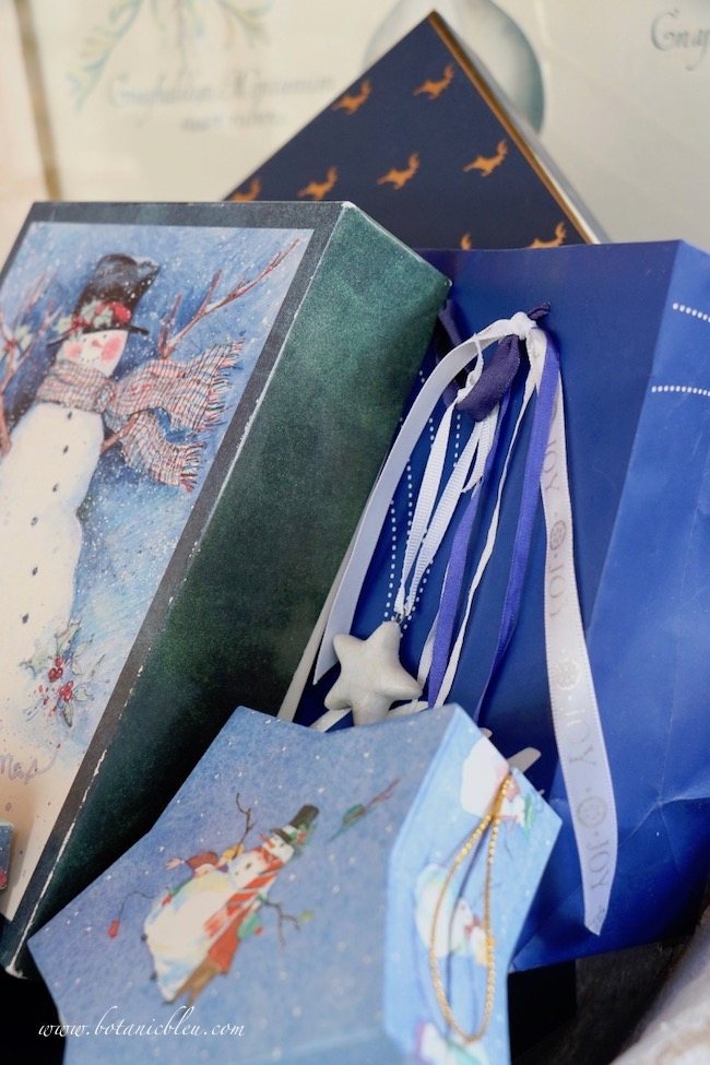 French country blue Christmas presents have smaller packages in front so larger packages details can be seen