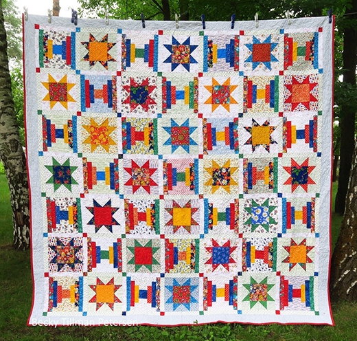 Orbit Quilt Designed by Becky Petersen of Quilted Twins