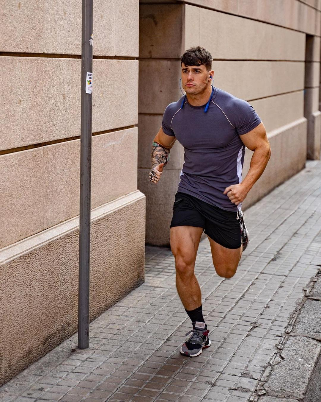 strong-legs-thigh-muscle-shirt-hunky-male-street-runner