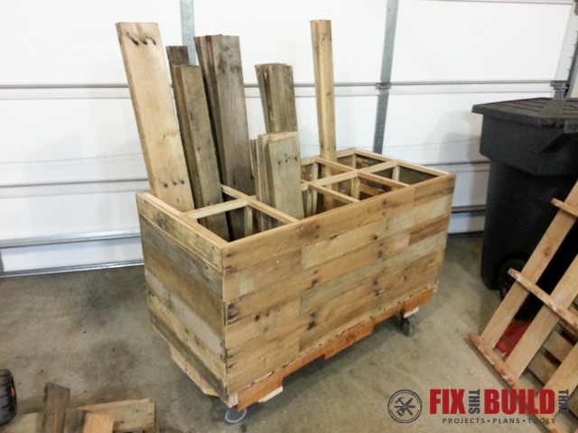 wooden rolling cart made out of pallets to store wood.