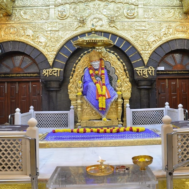Blue Color Clothes wear Sai baba in this images