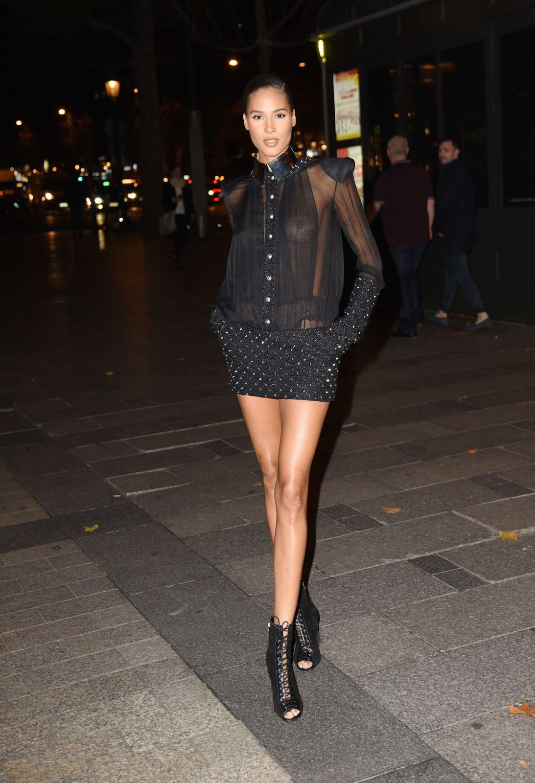Cindy Bruna goes sheer and braless at the Paris Fashion Week Opening