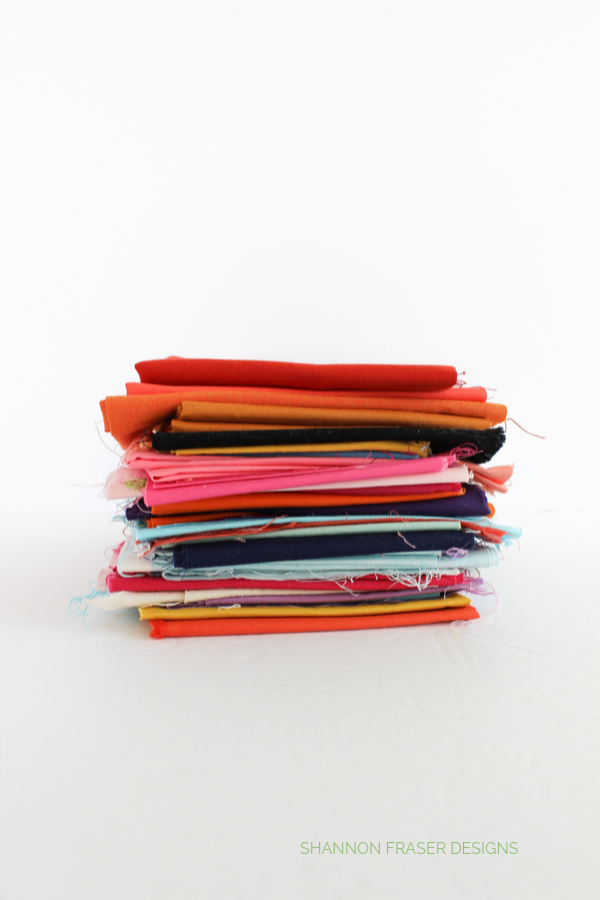 Stack of fabric scraps | Honest state of a modern quilter's WIP List | Q1 2020 Finish-a-Long | Shannon Fraser Designs #modernquilter #worksinprogress #fabricscraps #workingmystashoff