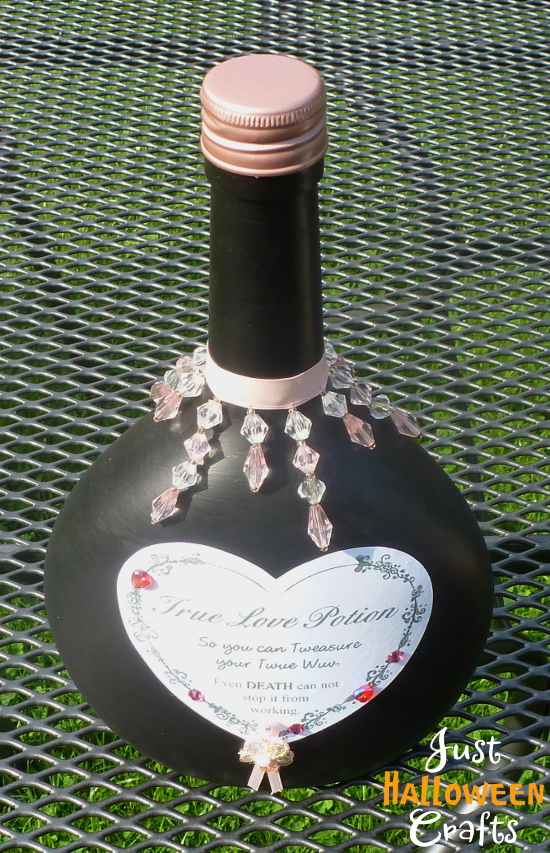 Black bottle with heart shaped label for true love apothecary design