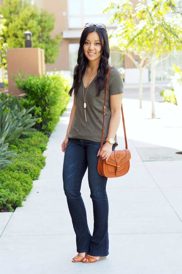olive tee + bootcut jeans + tassel necklace + cognac accessories