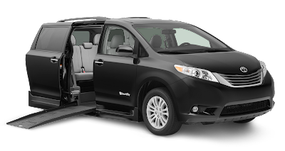 A black, Toyota Sienna Braun Rampvan. It's rear passenger door is opened, and its ramp deployed.