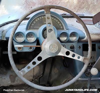 Steering wheel and gauges of 1959 Corvette field find.