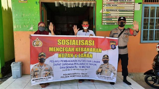 Polsek pematang karau Sosialisasikan pencegahan dan sanksi karhutla ke warga masyarakat