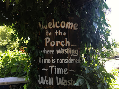 Love this Camp Sign - New Frontier RV Park