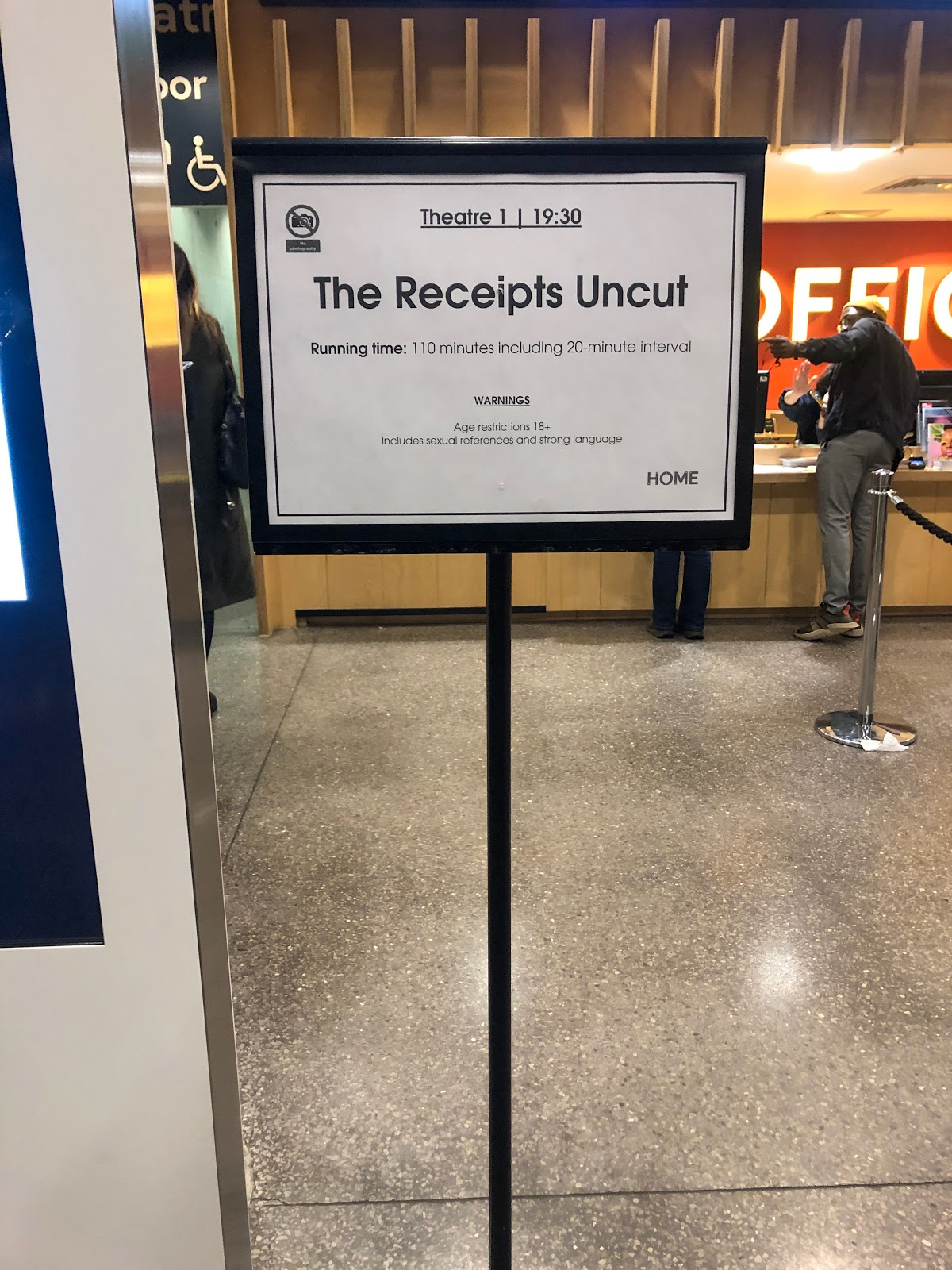 A sign for the start of the queue to collect tickets for The Reciepts Podcast Live