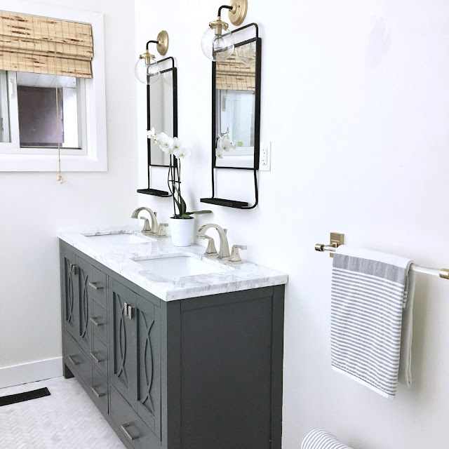 White-bathroom-makeover-rounded-rectangle-mirror-harlow-and-thistle-1