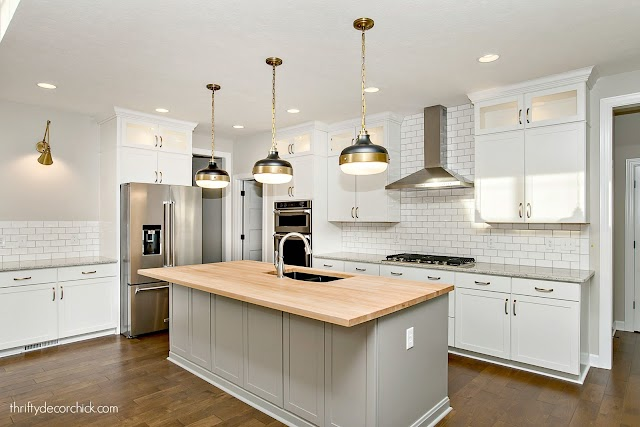 white kitchen with butcher block counters