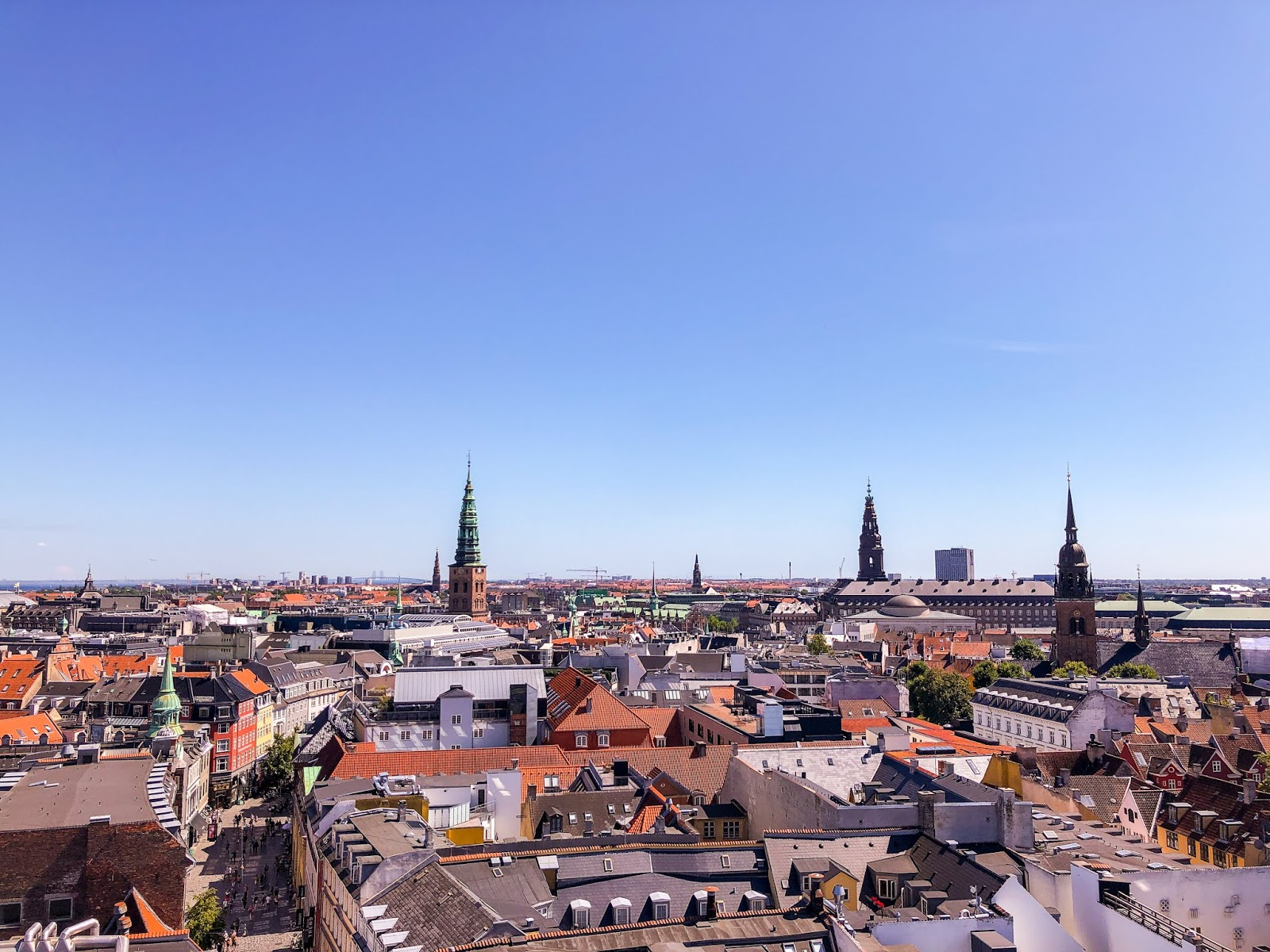 copenhagen itinerary; Copenhagen skyline with sunny blue sky from round tower