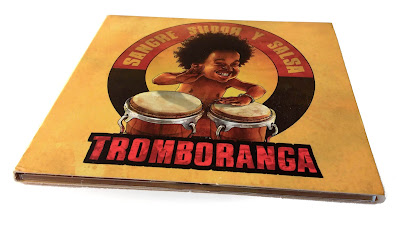 Cd cover with black boy playing bongos
