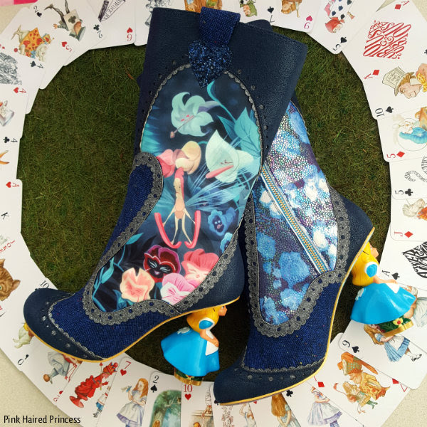 Irregular Choice Alice Lost Your Muchness boots surrounded by playing cards on grass