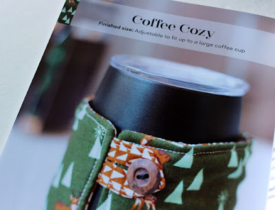 coffee cup wrapped in a cozy