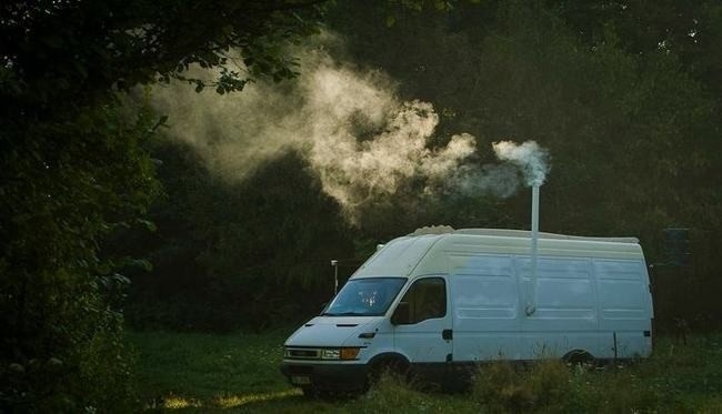 It even has an exhaust pipe to keep the fumes and smoke headed outside. - Amazing Off-Grid Traveling Home Was Made Out Of An Old Van… Wait Till You See The Inside.