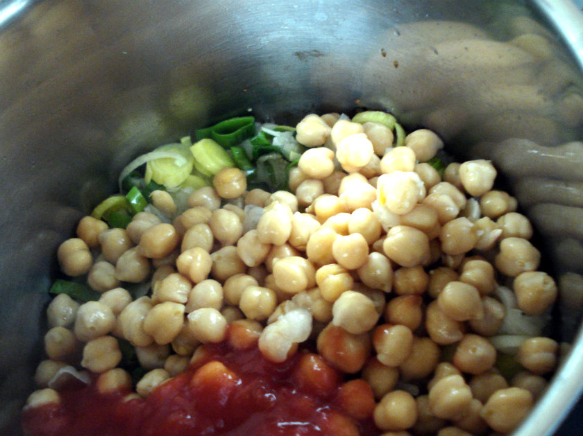 Add the chickpeas, stock and tomatoes.