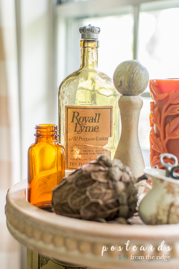 vintage bottles and fall decor on wood tiered tray