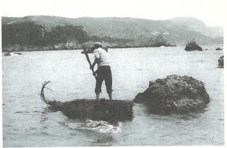 Papyrella raft in Corfu with standing paddler using a double-bladed paddle