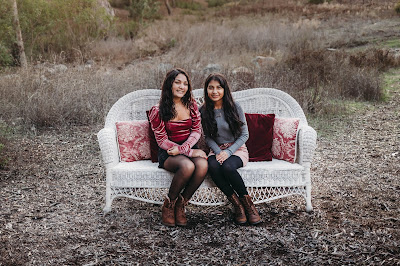 Teenage sisters holding hands posing for Christmas mini sessions with Morning Owl Fine Art Photography located in San Diego.