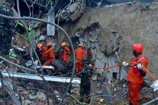 Hunt for buried survivors after Indonesia earthquake