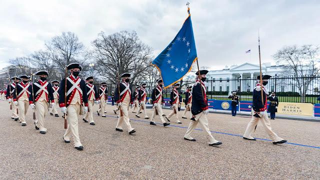 Soldiers rehearse ahead of Joe Biden's inauguration amid high tension in DC