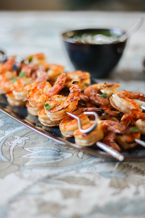 This crowd pleasing grilled shrimp recipe couldn't be easier to make! Served alongside a fresh and colorful chimichurri sauce, this is a dish you'll be making again and again!