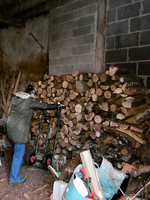 Stacking firewood.  Indre et Loire, France. Photographed by Susan Walter. Tour the Loire Valley with a classic car and a private guide.