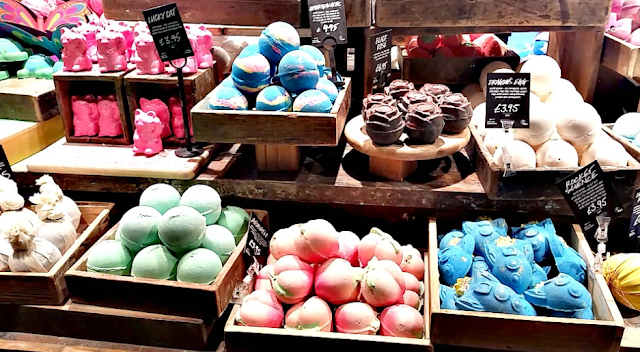 The shelves filled with Lush bath bombs