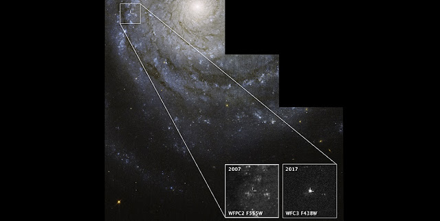 This NASA Hubble Space Telescope image of the nearby spiral galaxy NGC 3938 shows the location of supernova 2017ein, in a spiral arm near the bright core. The exploded star is a type Ic supernova, thought to detonate after its massive star has shed or been stripped of its outer layers of hydrogen and helium. Progenitor stars to type Ic supernovas have been hard to find. But astronomers sifting through Hubble archival images may have uncovered the star that detonated as supernova 2017ein. The location of the candidate progenitor star is shown in the pullout box at bottom left, taken in 2007. The bright object in the box at bottom right is a close-up image of the supernova, taken by Hubble in 2017, shortly after the stellar blast. NGC 3938 resides 65 million light-years away in the constellation Ursa Major. The Hubble image of NGC 3938 was taken in 2007. CREDIT: NASA/ESA/S. VAN DYK (CALTECH)/W. LI (UNIVERSITY OF CALIFORNIA)
