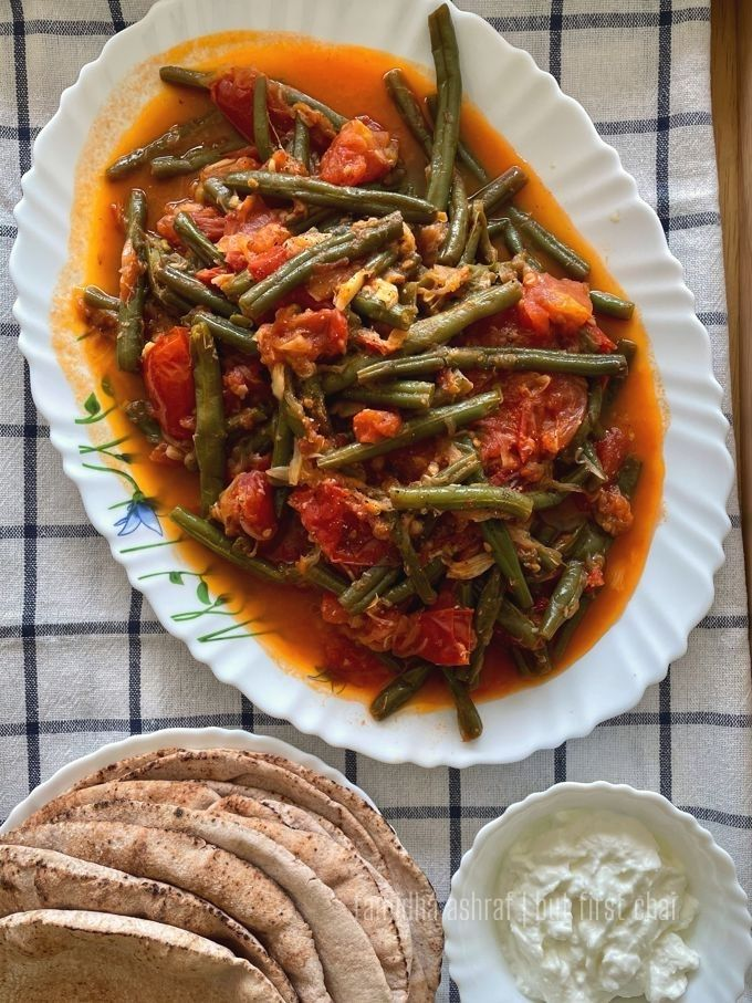 Lebanese Green Beans Stew served with a stack of pita bread