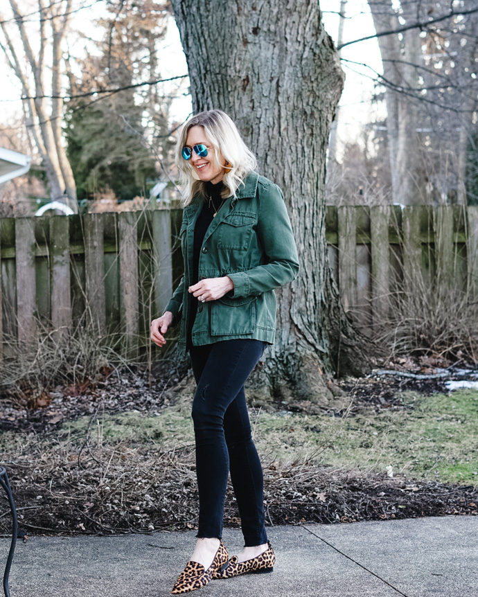 all black outfit with green army jacket