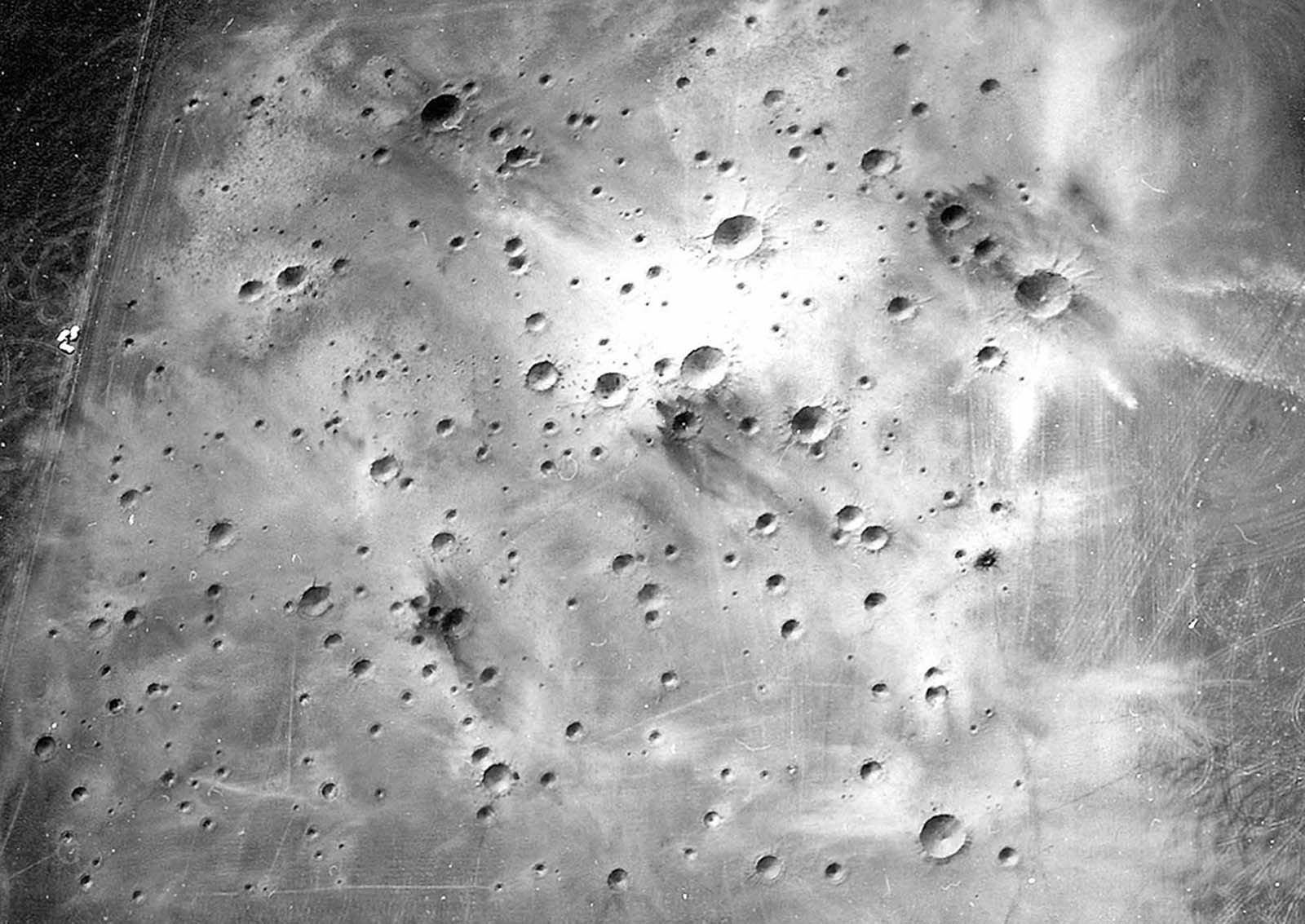 A post-explosion aerial view of the completed Cinder Lake Crater Field #2, showing very light ejecta caused by excavation of clay beds immediately below black basaltic cinders.