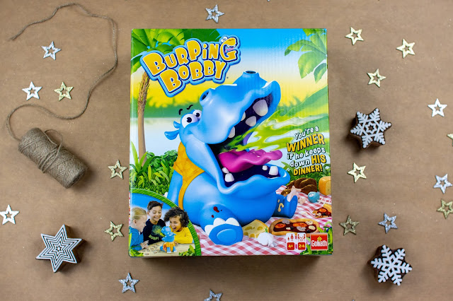 The box of Burping Bobby which is a fun game for 5 year olds where the hippo burps spraying water.