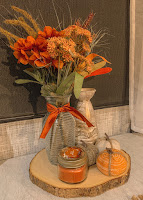 Vase Filled with Faux Fall Flower Arrangement